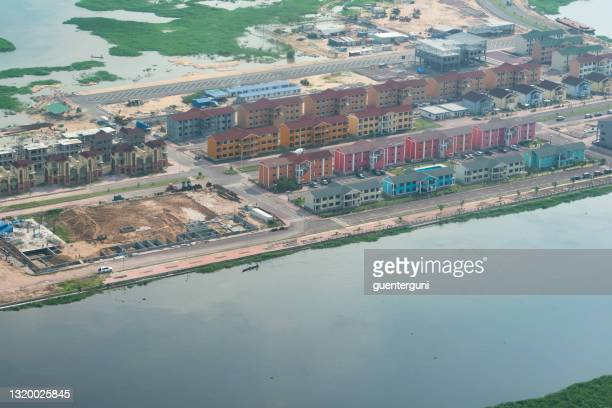 aerial view of a construction site of a planned residential area on an island in the congo river - kinshasa stock pictures, royalty-free photos & images