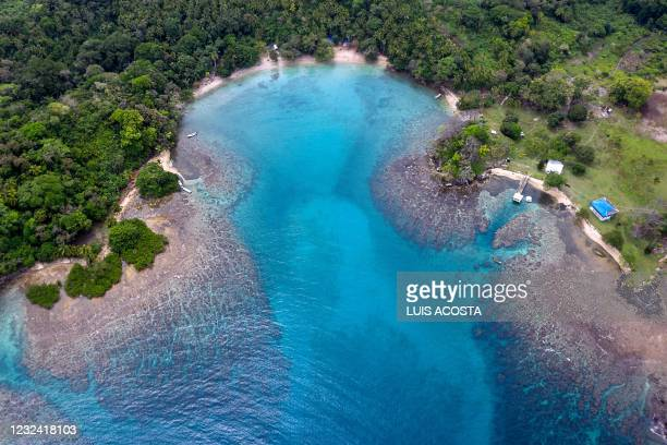 Aerial view of a coral reef area at Playa Blanca, in Portobelo, Colon province, Panama, on April 16, 2021. - Every two weeks, Marine Biology students...