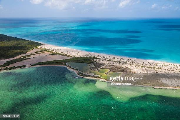 Aerial view of a corner of Barbuda, the Frigate Bird Sanctuary touches a thin strip of sand that separates the Caribbean Sea, Barbuda, Antigua and Barbuda, Leeward Islands, West Indies, Caribbean, Central America