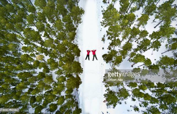 aerial view of a couple in the snow - winter sport stock pictures, royalty-free photos & images