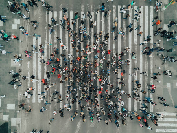 aerial view of a crossing in mexico city - people stock pictures, royalty-free photos & images