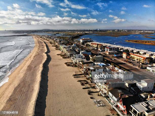 aerial view of a deserted beach at surf side, sunset beach area close to sunset - image title stock pictures, royalty-free photos & images