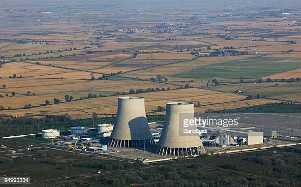Aerial view of a dismissed nuclear power plant among fields
