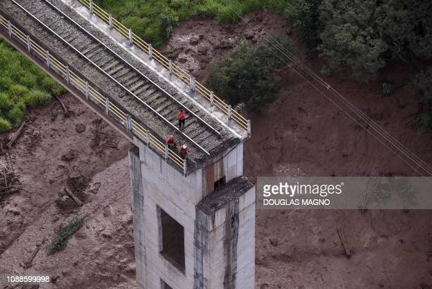 TOPSHOT Aerial view of a fallen bridge taken after the collapse of a dam which belonged to Brazil's giant mining company Vale near the town of...