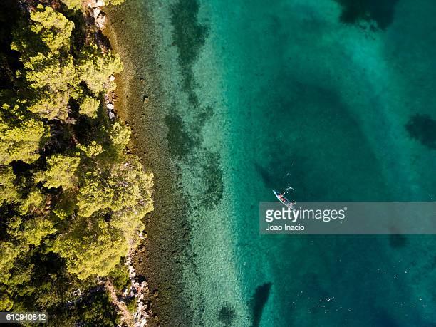 Aerial view of a family kayaking - Mljet National Park, Croatia