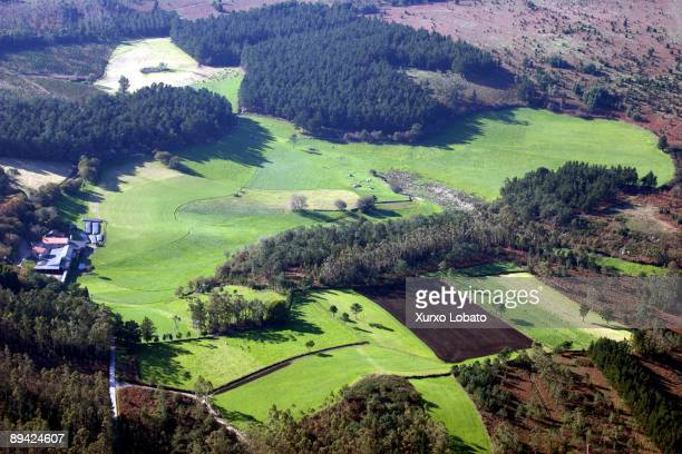 Aerial view of a farm and pastures at he county of La Coruna