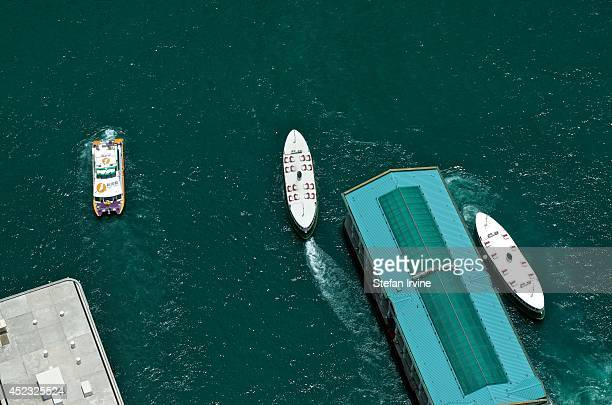 Aerial view of a ferry pier and a departing Star Ferry from the rooftop of IFC 2 in Central Hong Kong