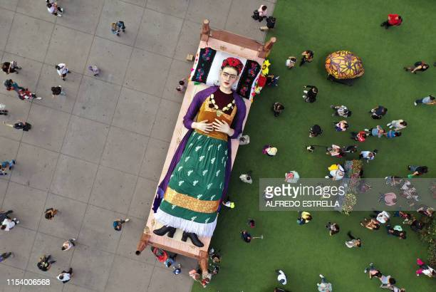 TOPSHOT Aerial view of a figure of Mexican artist and painter Frida Kahlo lying in bed taken on the inauguration day of the exhibition Los Colores de...
