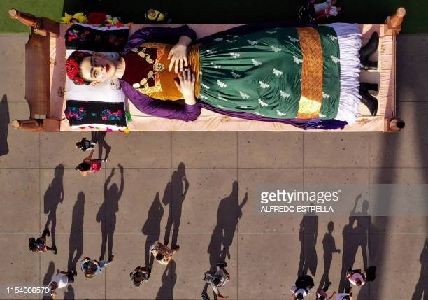 Aerial view of a figure of Mexican artist and painter Frida Kahlo lying in bed taken on the inauguration day of the exhibition Los Colores de Frida...