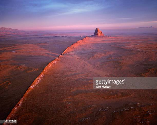 Aerial view of a fivemilelong volcanic dike that radiates from Shiprock a monumental landform sacred to the Navajo people Shiprock is the American...