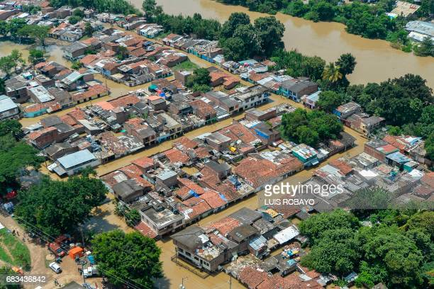 Aerial view of a flooded area in Cali Colombia on May 15 after heavy rains caused the overflowing of the Cauca river Flooding and mudslides in...