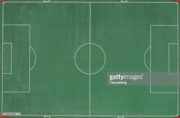 aerial view of a football field from above. - campo de futebol imagens e fotografias de stock