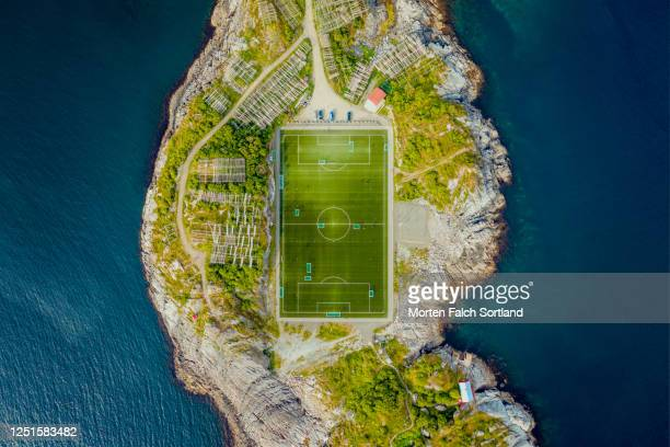 aerial view of a football field on an island in henningsvær, norway - football pitch stock pictures, royalty-free photos & images