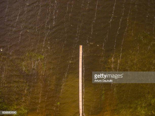 Aerial view of a footbridge stretching in the biggest lake in Latvia