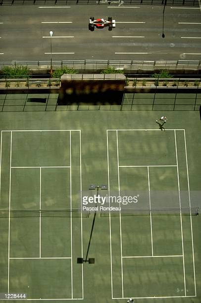 Aerial view of a Formula One car driving past tennis courts during the US Grand Prix at the Phoenix circuit in Arizona USA Mandatory Credit Pascal...