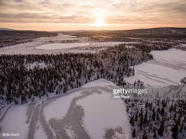 Aerial view of a frozen lake at Pallas-Yllästunturi National Park - Lapland, Finland