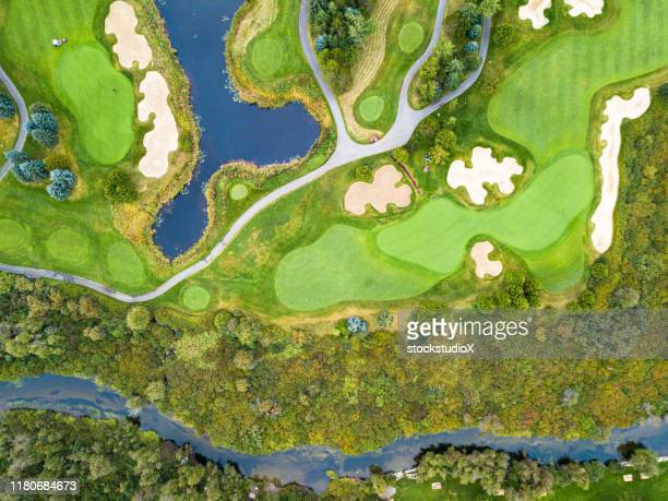 aerial view of a golf course - green golf course stock pictures, royalty-free photos & images