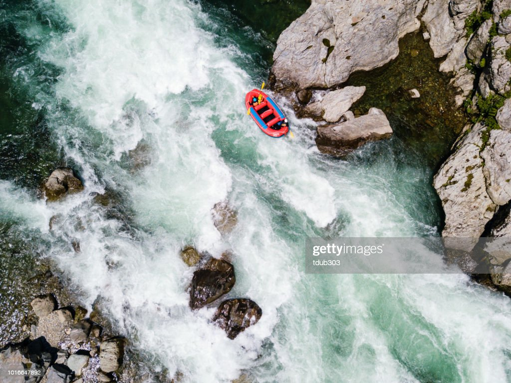 Aerial view of a group of men and women white water river rafting : Stock Photo