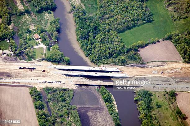 aerial view of a highway bridge construction project - crane construction machinery stock pictures, royalty-free photos & images