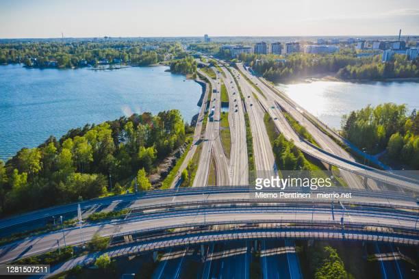 aerial view of a highway overpass next to seaside in espoo, finland - espoo - fotografias e filmes do acervo