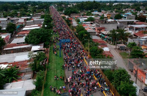 Aerial view of a Honduran migrant caravan heading to the US as it reaches the GuatemalaMexico international bridge in Tecun Uman Guatemala on October...