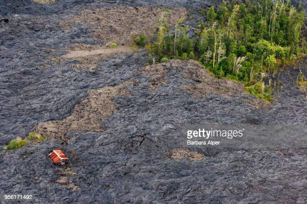 Aerial view of a house surrounded by hardened lava from a previous volcano eruption on the island of Hawaii Hawaii December 21 2007