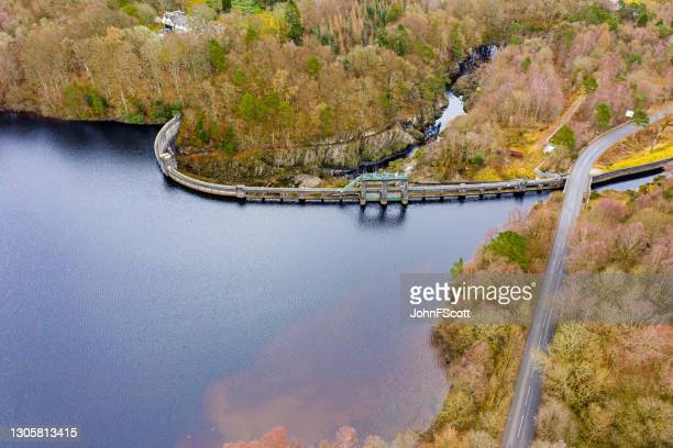 aerial view of a hydro electric dam on a lake - johnfscott stock pictures, royalty-free photos & images