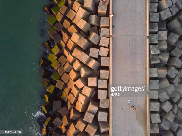 aerial view of a jetty at the entrance of the harbour of scheveningen - the hague stock pictures, royalty-free photos & images