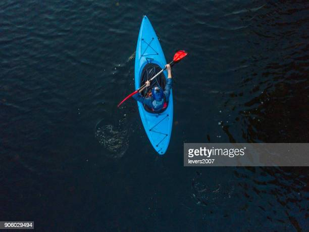 aerial view of a kayaker on a river, dublin, ireland. - kayak stock pictures, royalty-free photos & images