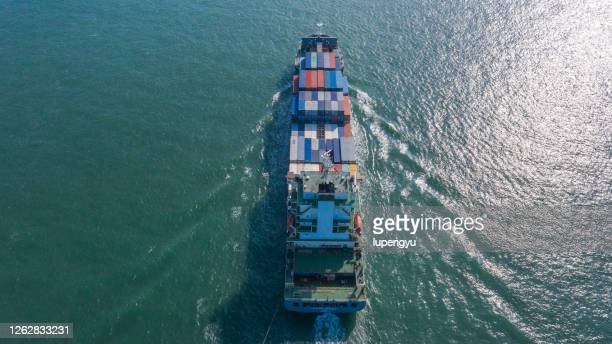 aerial view of a large container ship full loaded with containers and cargo - wide angle stock pictures, royalty-free photos & images
