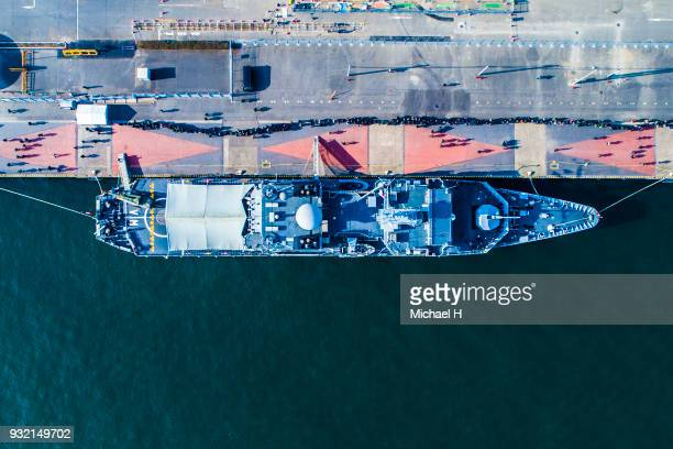 aerial view of a large ship anchored at the port. - military ship stock pictures, royalty-free photos & images