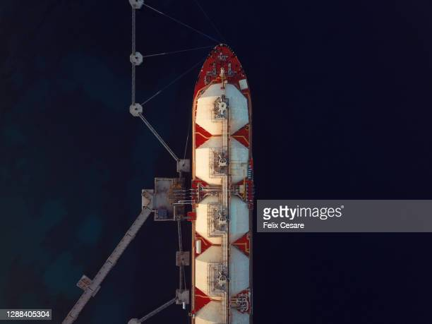 aerial view of a liquified natural gas ship moored at the jetty. - 液化天然ガス ストックフォトと画像