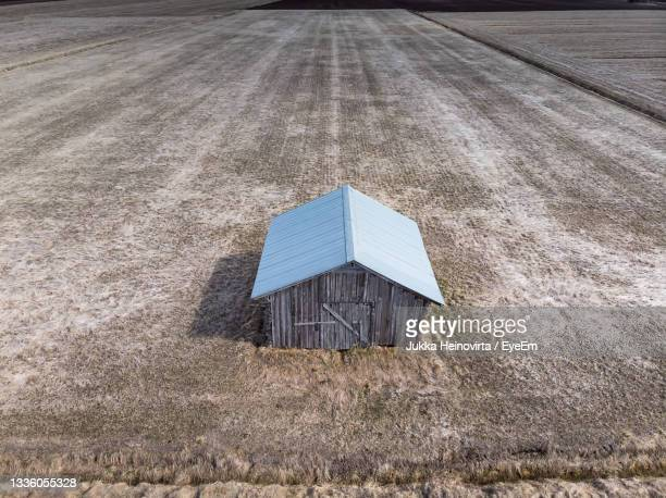 aerial view of a lonely barn house on the springtime fields - heinovirta stock pictures, royalty-free photos & images