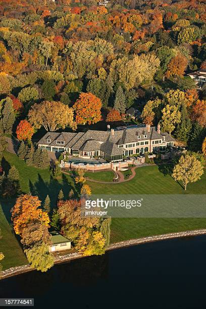 Aerial view of a luxury lake home in Autumn.