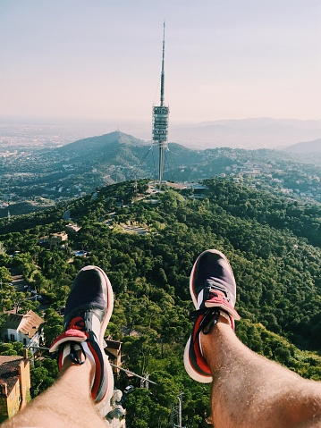 Aerial view of a man from personal perspective with feets in frame in Barcelona, Spain - gettyimageskorea