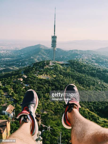 Aerial view of a man from personal perspective with feets in frame in Barcelona, Spain