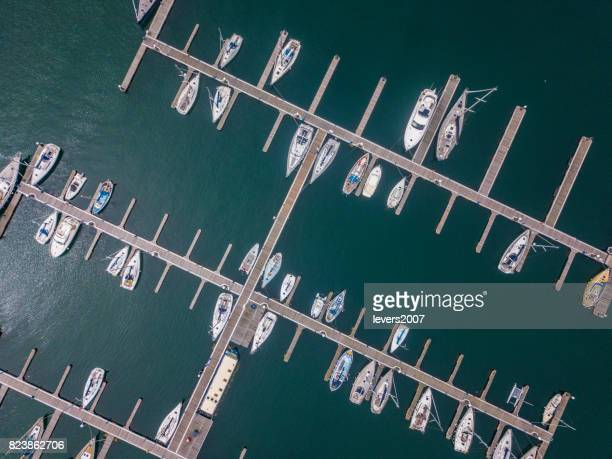 aerial view of a marina - marina stock photos and pictures