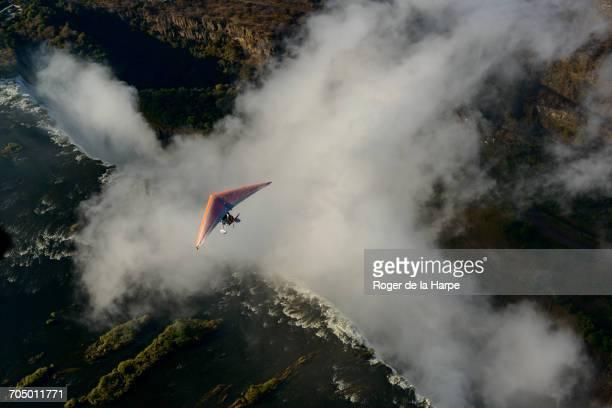 aerial view of a micorlight (ultralight) flying over the zambezi river and victoria falls. livingstone. zambia - aereo ultraleggero foto e immagini stock