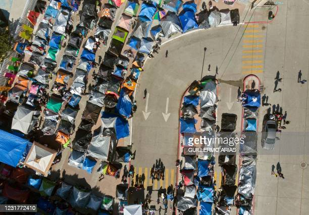 Aerial view of a migrants camp where asylum seekers wait for US authorities to allow them to start their migration process outside El Chaparral...