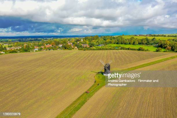 aerial view (drone shot) of a mill in the center of a field. - looking down stock pictures, royalty-free photos & images