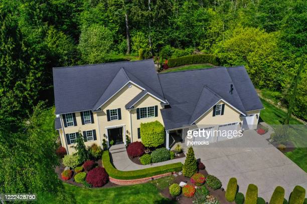 aerial view of a modern american craftsman style house exterior - drone point of view stock pictures, royalty-free photos & images