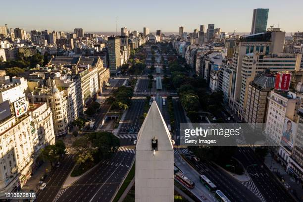 Aerial view of a nearly empty 9 de Julio Avenue on the first day of total quarantine on March 20 2020 in Buenos Aires Argentina President Alberto...
