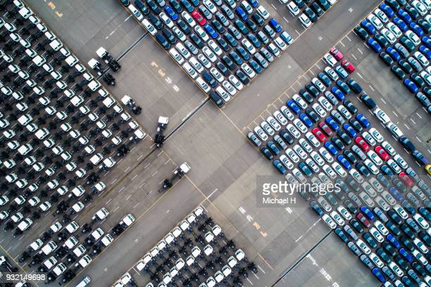 aerial view of a parked car column. - car transporter stock photos and pictures
