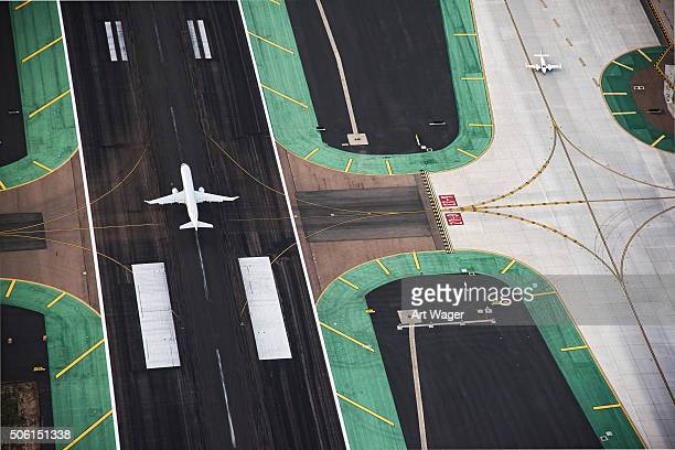 aerial view of a passenger jet on the runway - airport runway stock pictures, royalty-free photos & images