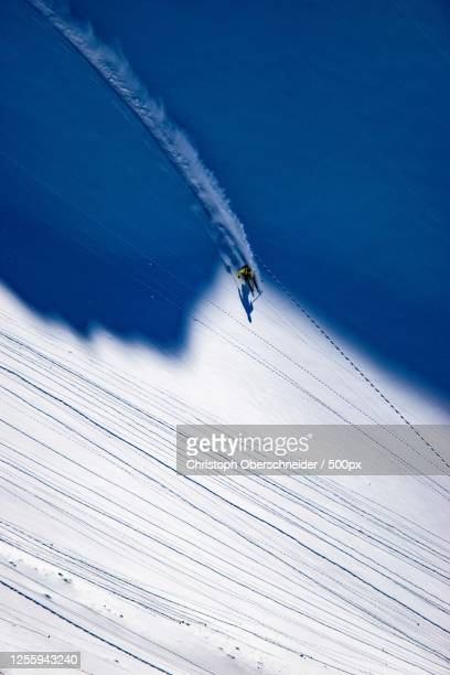 aerial view of a person skiing on snow, schladming, austria - schladming stock pictures, royalty-free photos & images