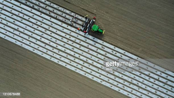 Aerial view of a pilotless seeding machine sowing cotton seeds in a field on April 3, 2021 in Yuli County, Bayingolin Mongol Autonomous Prefecture,...