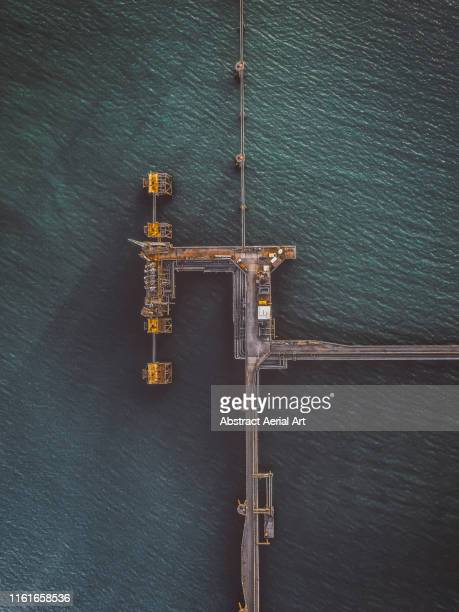 aerial view of a pipeline, milford haven, wales, united kingdom - industry stock pictures, royalty-free photos & images