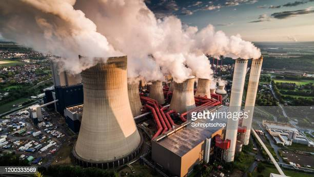 aerial view of a power station - greenhouse gas stock pictures, royalty-free photos & images