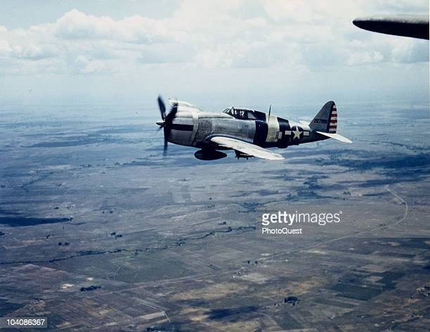 Aerial view of a Republic Aviation P-47D Thunderbolt in flight over North Luzon, Philippines, April 20, 1945.
