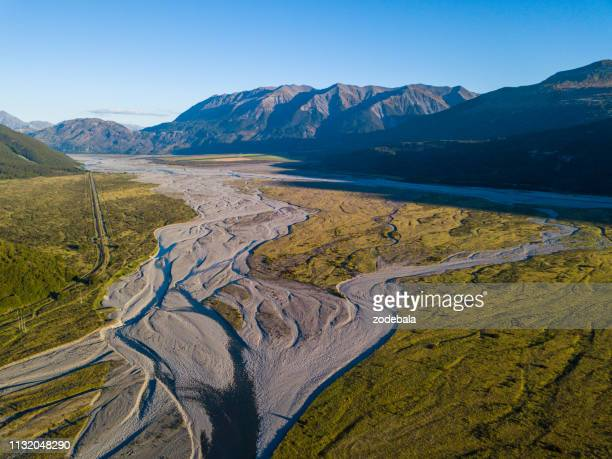 aerial view of a river in new zealand - enacting stock pictures, royalty-free photos & images